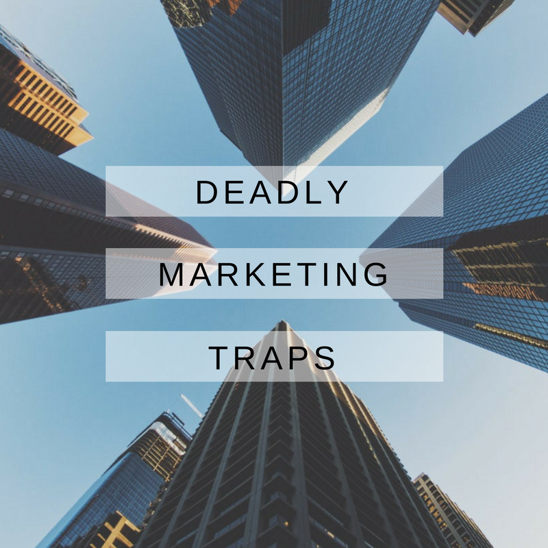 photo of big city scyscrapers, pointing from the ground vertically towards the sky with the text Deadly Marketing Traps